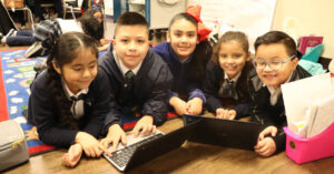 Cityscape-Schools-students-with-computer